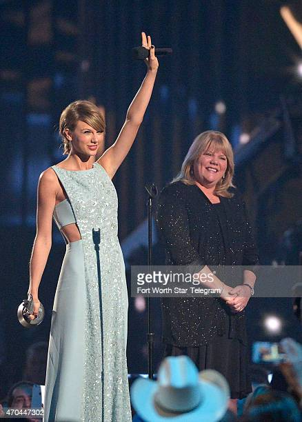 Taylor Swift receives a Milestone award from her mother Andrea at The 50th Annual Academy of Country Music Awards at ATT Stadium on Sunday April 19...