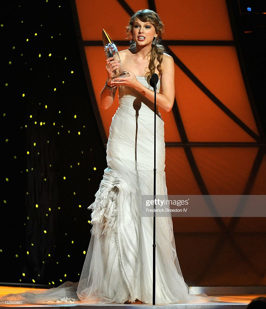 Taylor Swift receives the CMA Award for Entertainer of the Year at the 45th annual CMA Awards at the Bridgestone Arena on November 9, 2011 in Nashville, Tennessee.