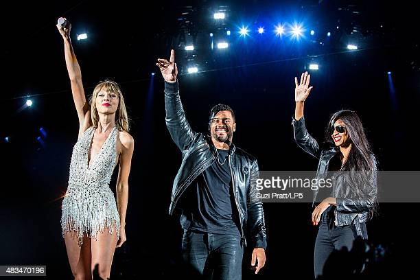 Taylor Swift, Russell Wilson and Ciara perform at CenturyLink Field on August 8, 2015 in Seattle, Washington.