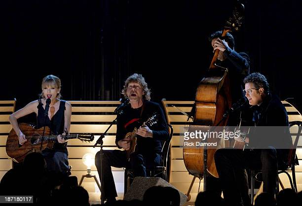 Taylor Swift Sam Bush Edger Miller and Vince Gill perform onstage during the 47th annual CMA Awards at the Bridgestone Arena on November 6 2013 in...