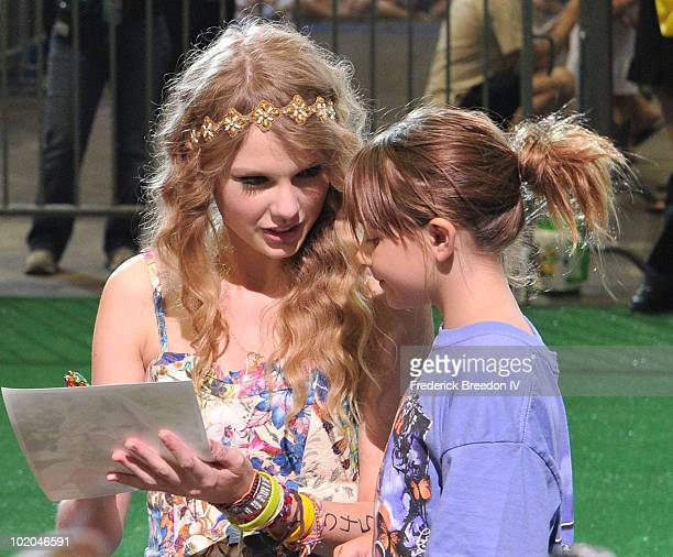 Taylor Swift signs an autograph for one of the thousands of young fans at the Taylor Swift 13Hour Meet Greet at the Bridgestone Arena during the 2010...