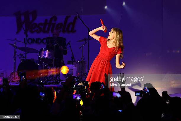 Taylor Swift switches on the Christmas lights and performs for fans and shoppers at Westfield London White City/Shepherd's Bush on November 6 2012 in...