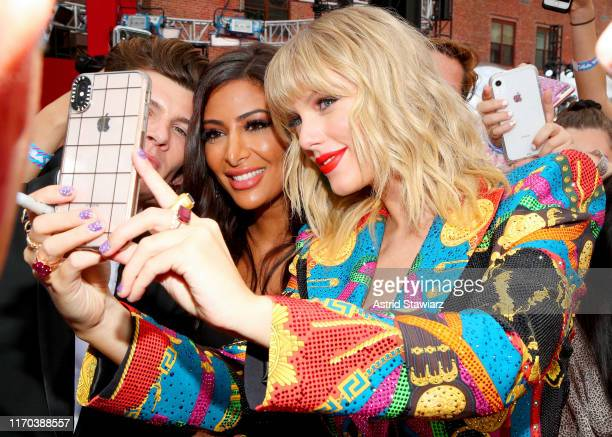 Taylor Swift takes a selfie with a fan during the 2019 MTV Video Music Awards at Prudential Center on August 26 2019 in Newark New Jersey