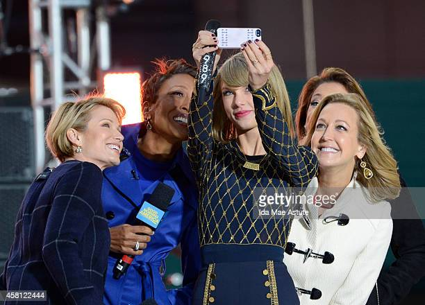 Taylor Swift takes a selfie with the GMA team in Times Square on GOOD MORNING AMERICA, 10/30/14, airing on the Walt Disney Television via Getty...