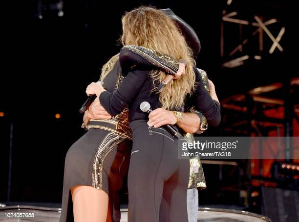 Taylor Swift Tim McGraw and Faith Hill embrace onstage during the Reputation Stadium Tour at Nissan Stadium on August 25 2018 in Nashville Tennessee