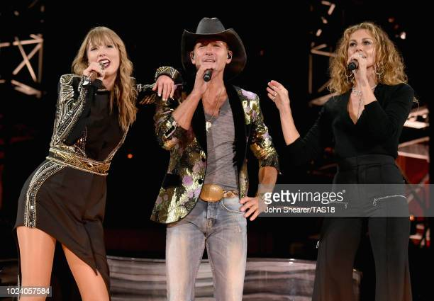 Taylor Swift Tim McGraw and Faith Hill perform onstage during the Reputation Stadium Tour at Nissan Stadium on August 25 2018 in Nashville Tennessee