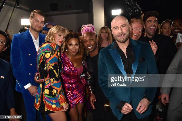 Taylor Swift Todrick Hall John Travolta and Jesse Tyler Ferguson pose backstage during the 2019 MTV Video Music Awards at Prudential Center on August...