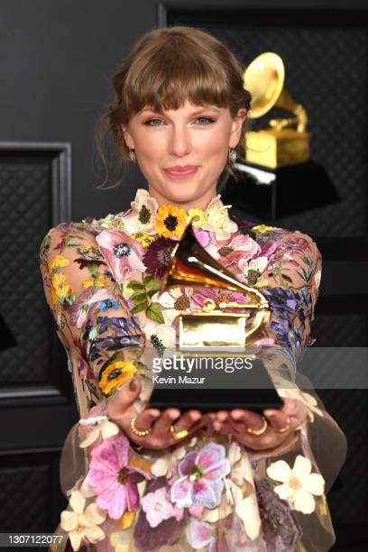 Taylor Swift, winner of the Album of the Year award for 'Folklore,' poses in the media room during the 63rd Annual GRAMMY Awards at Los Angeles...