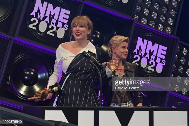 Taylor Swift winner of the award for Best Solo Act In The World and Robyn winner of Songwriter Of The Dedade attend The NME Awards 2020 at the O2...