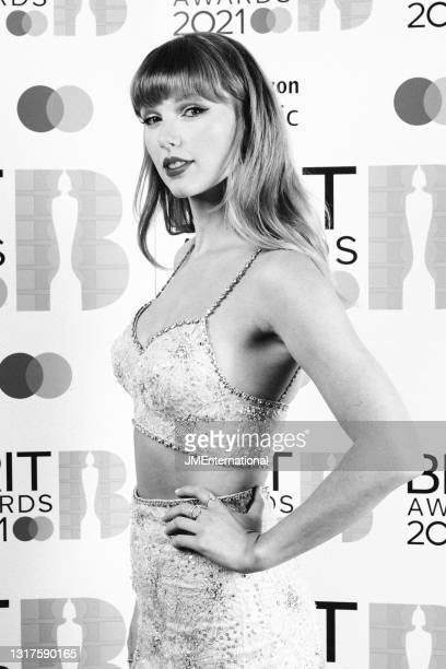 Taylor Swift, winner of the Global Icon award poses in the media room during The BRIT Awards 2021 at The O2 Arena on May 11, 2021 in London, England.