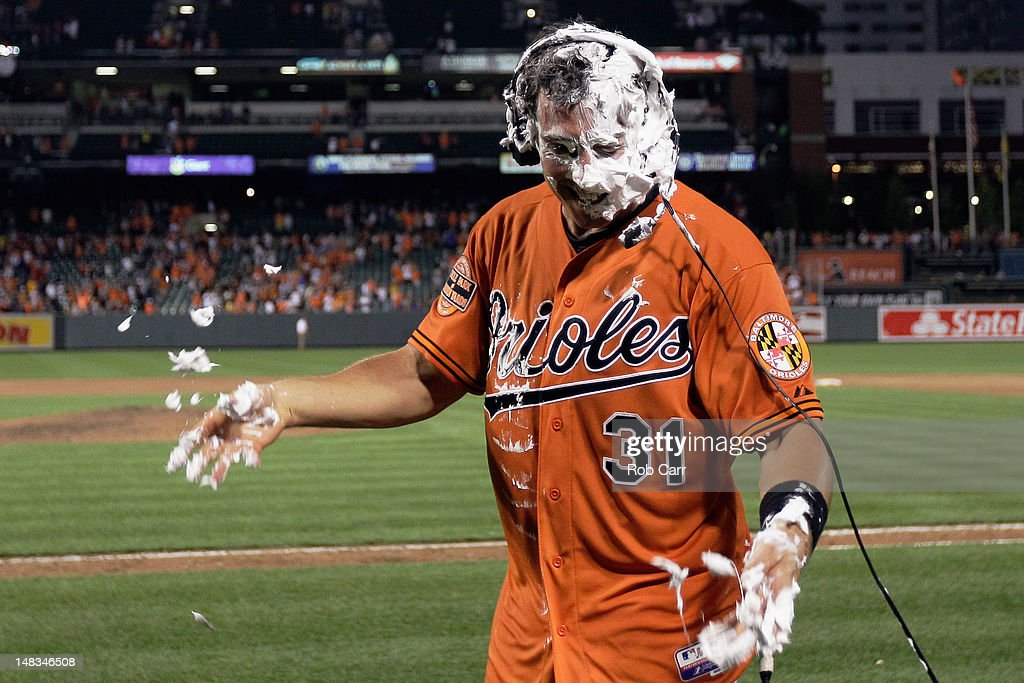 Taylor Teagarden #31 of the Baltimore Orioles is interviewed after teammates doused him with shaving cream after hitting the game winning home run to defeat the Detroit Tigers 8-6 in thirteen innings at Oriole Park at Camden Yards on July 14, 2012 in Baltimore, Maryland.
