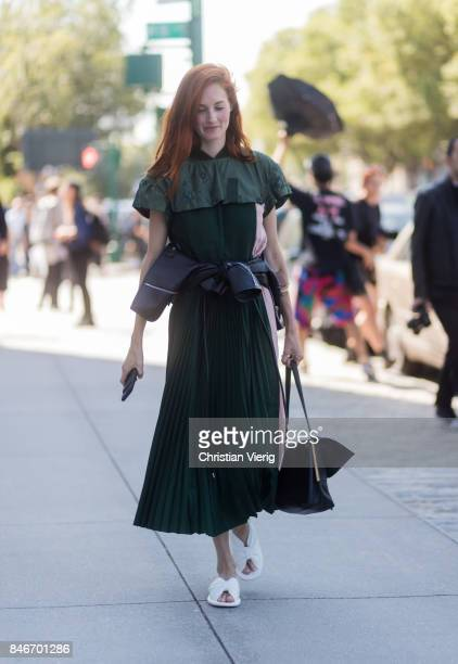 Taylor Tomasi Hill wearing green dress seen in the streets of Manhattan outside Delpozo during New York Fashion Week on September 13 2017 in New York...