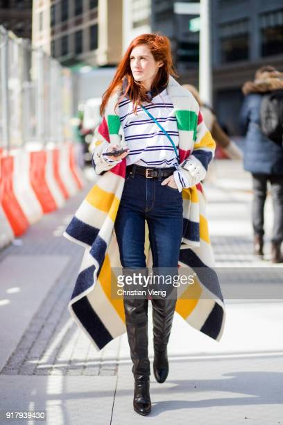 Taylor Tomasi Hill wearing striped coat overknee boots navy denim jeans seen outside Gabriela Hearst on February 13 2018 in New York City