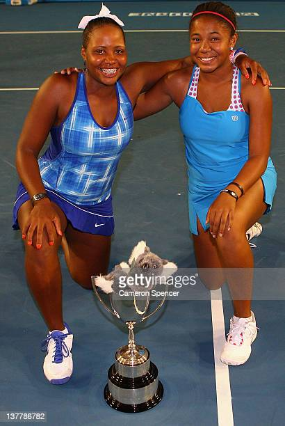 Taylor Townsend and partner Gabrielle Andrews of the United States of America pose with the winner's trophy after winning the junior girls' doubles...