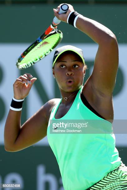 Taylor Townsend returns a shot to Magda Linette of Poland during the BNP Paribas Open at the Indian Wells Tennis Garden on March 9 2017 in Indian...