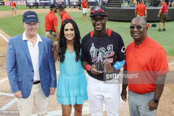 Taylor Trammell of the Cincinnati Reds and the U.S. Team poses with the Larry Doby Award after defeating the World Team in the SiriusXM All-Star...