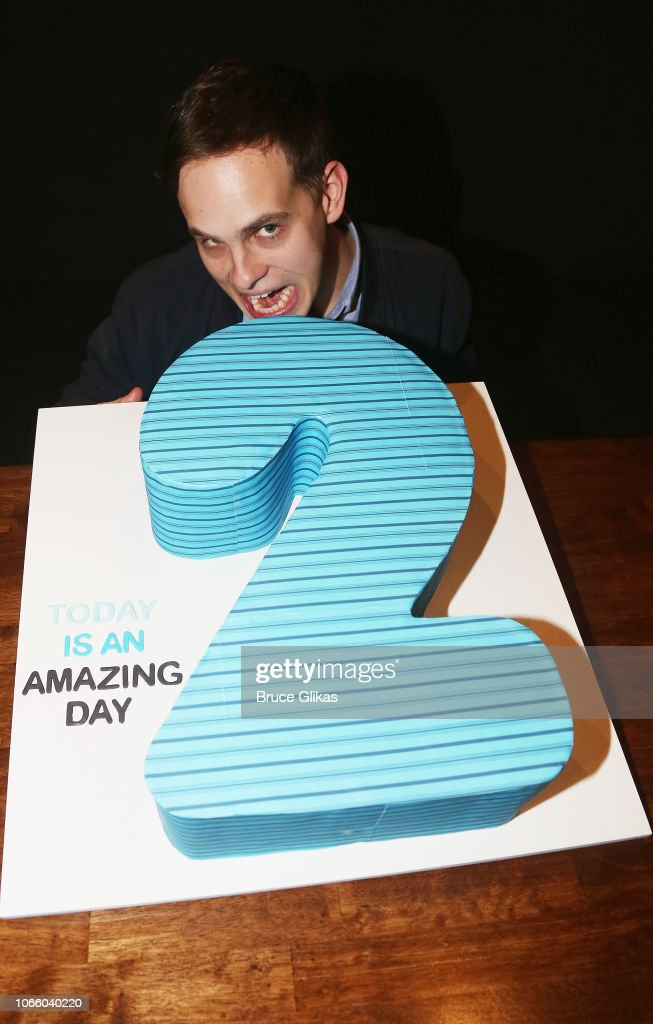 Taylor Trensch Poses With The 2nd Anniversary Cake After A News