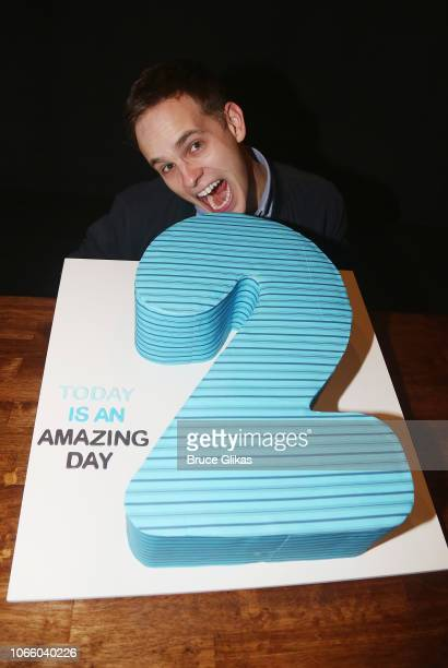 Taylor Trensch poses with the 2nd Anniversary cake after a Smithsonion Museum Donation ceremony for Dear Evan Hansen on Broadway at The Music Box...
