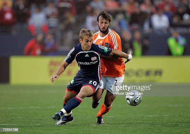 Taylor Twellman of the New England Revolution and Eddie Robinson of the Houston Dynamo vie for the ball during the 2006 MLS Cup at Pizza Hut Park on...