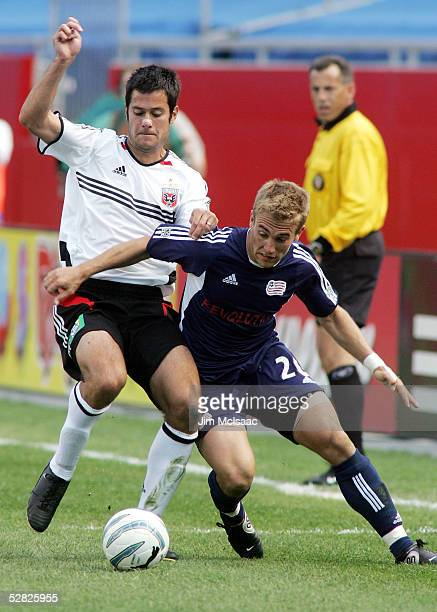 Taylor Twellman of the New England Revolution battles for the ball against Mike Petke of DC United during their game at Gillette Stadium on May 14...