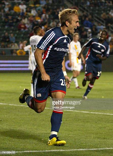 Taylor Twellman of the New England Revolution celebrates after scoring the goahead and eventual gamewinning goal seconds after the Los Angeles Galaxy...