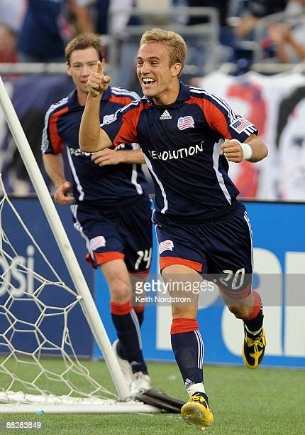 Taylor Twellman of the New England Revolution celebrates his 100th career goal during match against the New York Red Bulls June 7 2009 at Gillette...