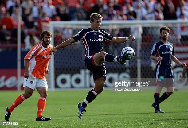 Taylor Twellman of the New England Revolution jumps to control the ball during the 2006 MLS Cup against the Houston Dynamo at Pizza Hut Park on...