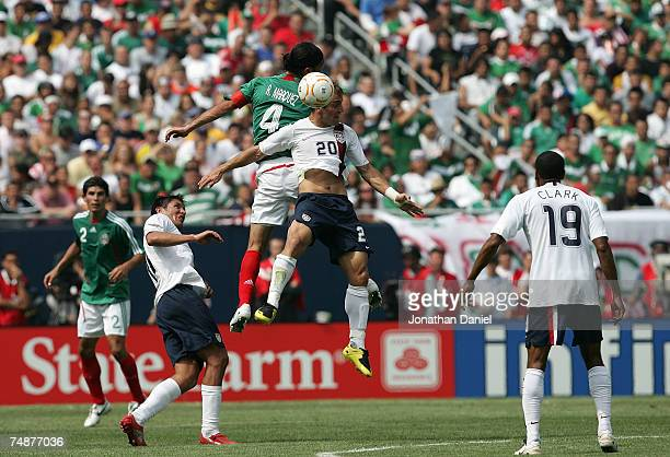 Taylor Twellman of the USA heads the ball against Rafael Marquez of Mexico during the CONCACAF Gold Cup Final match at Soldier Field on June 24 2007...