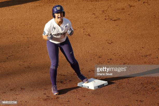 Taylor Van Zee of the Washington celebrates a run against the Florida State Seminoles races to third base against the Washington Huskies during the...