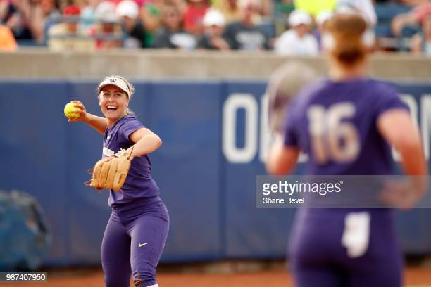 Taylor Van Zee of the Washington celebrates after catching a pop up for an out against the Florida State Seminoles during the Division I Women's...