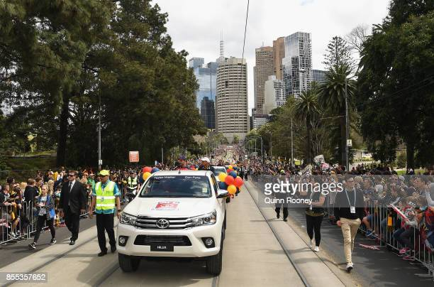 Taylor Walker and Don Pyke of the Crows wave to the crowd during the 2017 AFL Grand Final Parade on September 29 2017 in Melbourne Australia