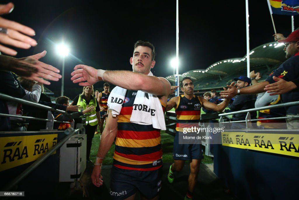 Taylor Walker and Eddie Betts of the Crows celebrate as they come from the field after the round four AFL match between the Adelaide Crows and the Essendon Bombers at Adelaide Oval on April 15, 2017 in Adelaide, Australia.
