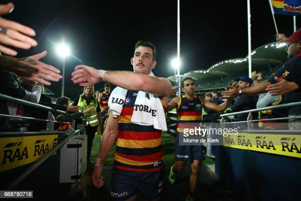 Taylor Walker and Eddie Betts of the Crows celebrate as they come from the field after the round four AFL match between the Adelaide Crows and the...