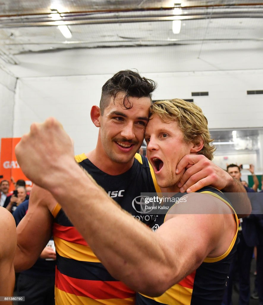 Taylor Walker and Rory Sloane of the Crows celebrate after the First AFL Preliminary Final match between the Adelaide Crows and the Geelong Cats at Adelaide Oval on September 22, 2017 in Adelaide, Australia.