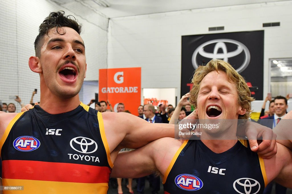 Taylor Walker and Rory Sloane of the Crows sing the club song after the First AFL Preliminary Final match between the Adelaide Crows and the Geelong Cats at Adelaide Oval on September 22, 2017 in Adelaide, Australia.
