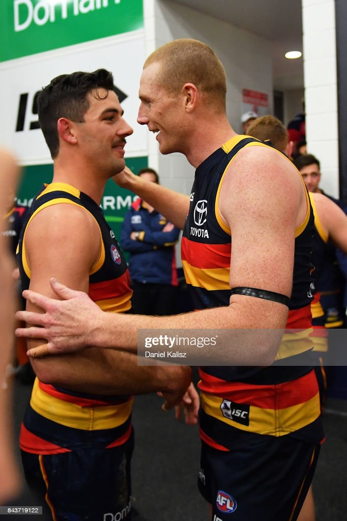 Taylor Walker and Sam Jacobs of the Crows celebrate after during the AFL First Qualifying Final match between the Adelaide Crows and the Greater Western Sydney Giants at Adelaide Oval on September 7, 2017 in Adelaide, Australia.