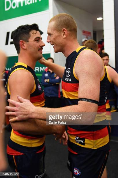 Taylor Walker and Sam Jacobs of the Crows celebrate after during the AFL First Qualifying Final match between the Adelaide Crows and the Greater...