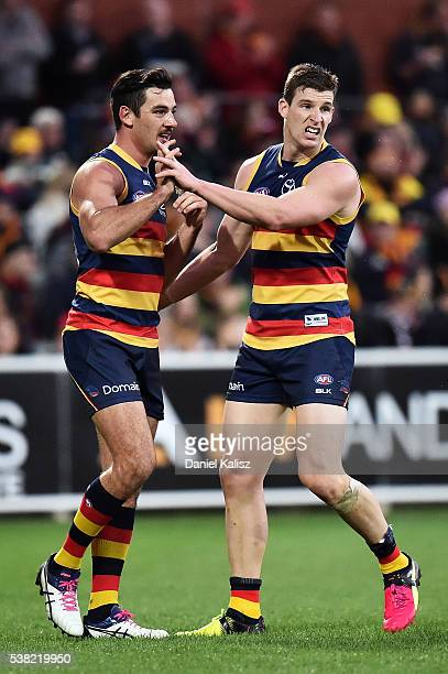 Taylor Walker is congratulkated by Josh Jenkins of the Crows during the round 11 AFL match between the Adelaide Crows and the St Kilda Saints at...