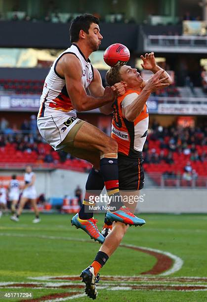 Taylor Walker of the Crows and Adam Kennedy of the Giants contest a mark during the round 16 AFL match between the Greater Western Giants and the...
