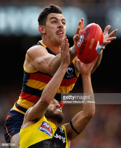 Taylor Walker of the Crows and Bachar Houli of the Tigers compete for the ball during the 2017 Toyota AFL Grand Final match between the Adelaide...