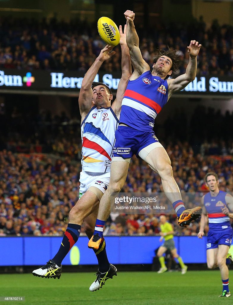 Taylor Walker of the Crows and Easton Wood of the Bulldogs contest the ball during the 2015 AFL Second Elimination Final match between the Western Bulldogs and the Adelaide Crows at the Melbourne Cricket Ground on September 12, 2015 in Melbourne, Australia.