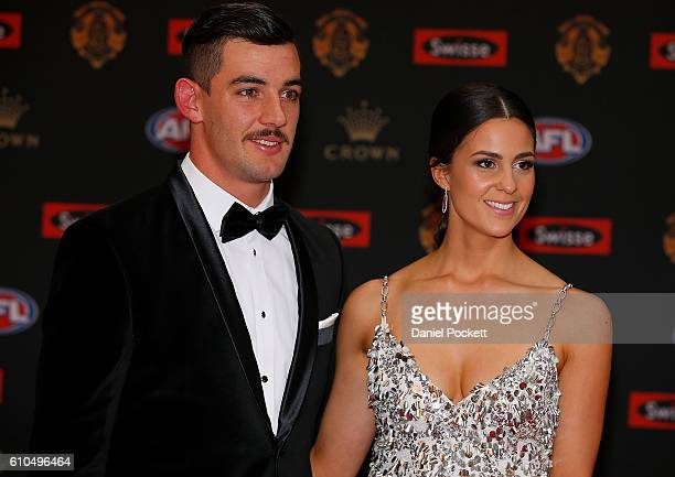 Taylor Walker of the Crows and Ellie Brown arrive ahead of the 2016 Brownlow Medal at Crown Entertainment Complex on September 26 2016 in Melbourne...