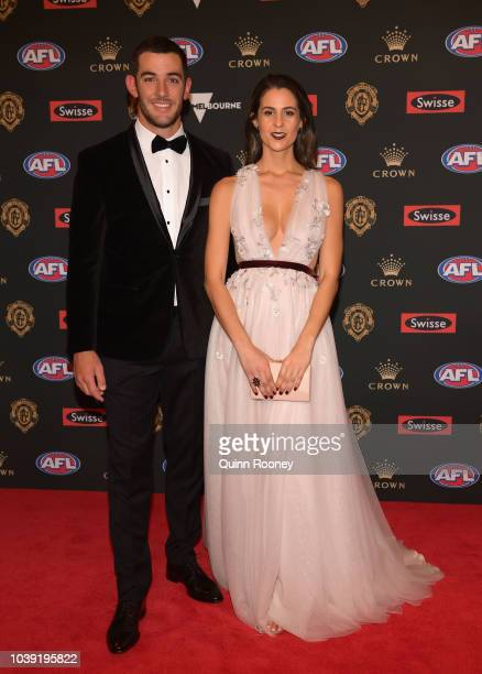 Taylor Walker of the Crows and his partner Ellie Brown arrives ahead of the 2018 Brownlow Medal at Crown Entertainment Complex on September 24 2018...