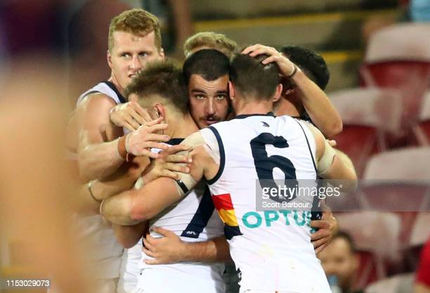 Taylor Walker of the Crows and his teammates celebrate at the final siren and winning the round 11 AFL match between the Melbourne Demons and the...