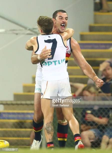 Taylor Walker of the Crows and Jordan Gallucci of the Crows celebrate at the final siren and winning the round 11 AFL match between the Melbourne...