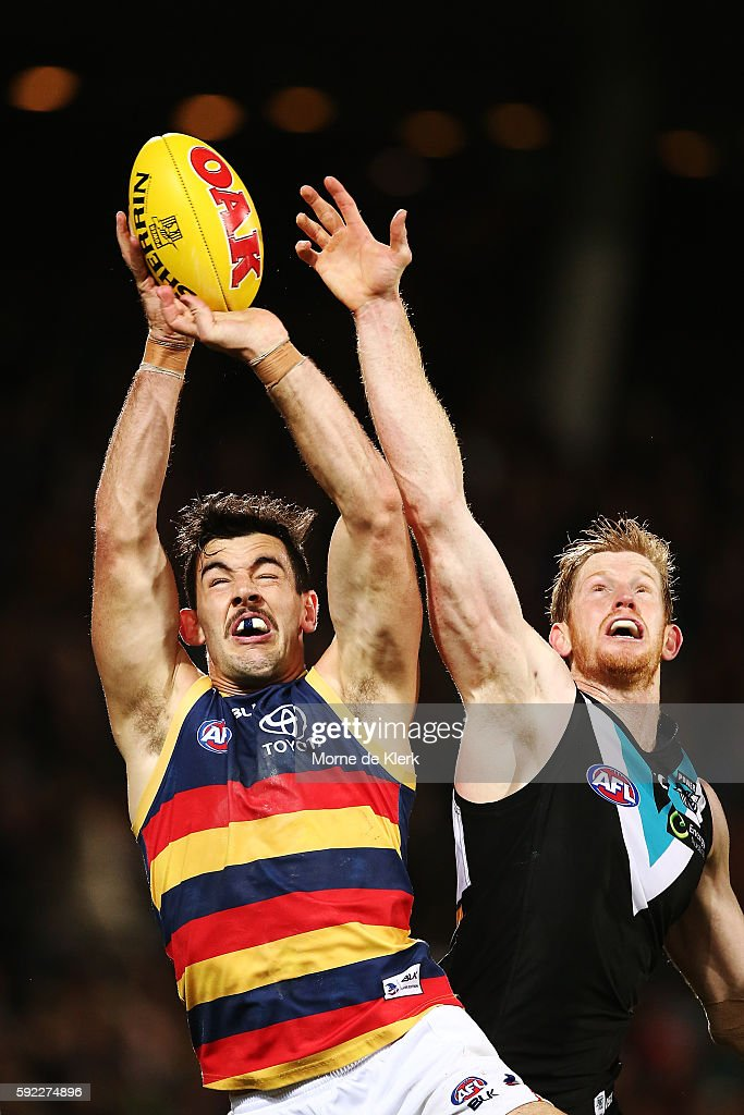 Taylor Walker of the Crows and Matthew Lobbe of the Power compete for the ball during the round 22 AFL match between the Port Adelaide Power and the Adelaide Crows at Adelaide Oval on August 20, 2016 in Adelaide, Australia.