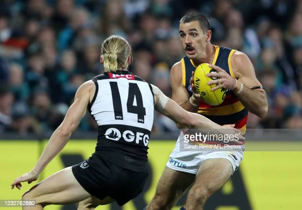 Taylor Walker of the Crows and Miles Bergman of the Power during the 2021 AFL Round 08 match between the Port Adelaide Power and the Adelaide Crows...