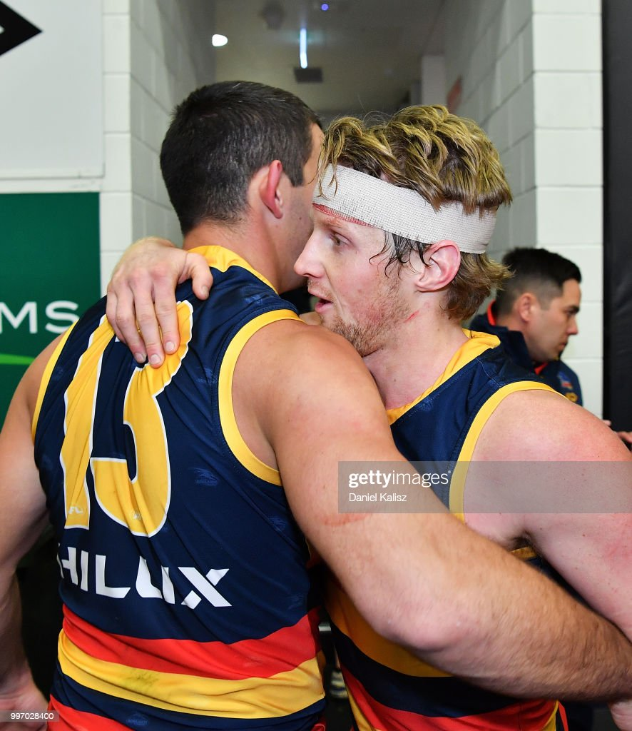 Taylor Walker of the Crows and Rory Sloane of the Crows celebrate after the round 17 AFL match between the Adelaide Crows and the Geelong Cats at Adelaide Oval on July 12, 2018 in Adelaide, Australia.