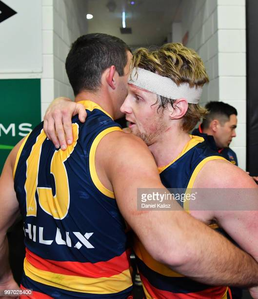 Taylor Walker of the Crows and Rory Sloane of the Crows celebrate after the round 17 AFL match between the Adelaide Crows and the Geelong Cats at...