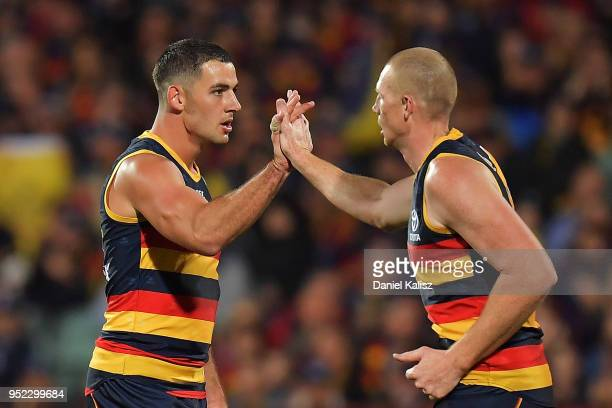 Taylor Walker of the Crows and Sam Jacobs of the Crows celebrate during the round six AFL match between the Adelaide Crows and Gold Coast Suns at...